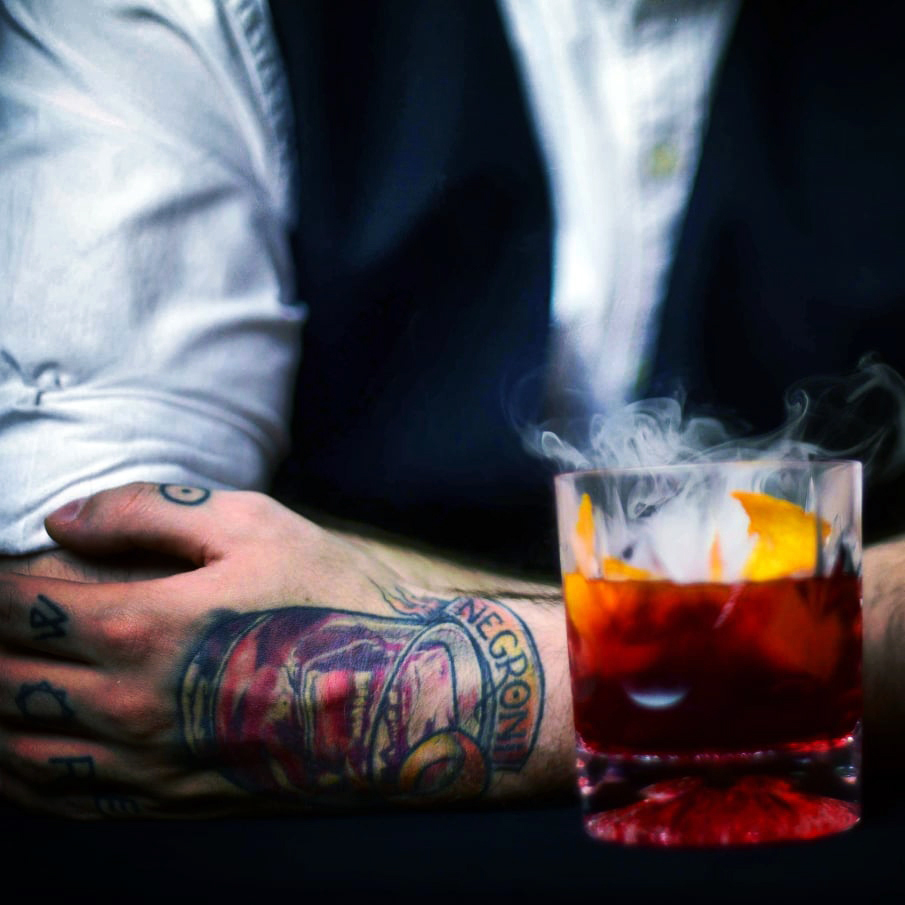 BAKED NEGRONI - 2 oz Dr. Zzyzx Caraway Vodka1.5 oz Campari1.5 oz Red VermouthShake with ice & strain*Optional top with mesquite smoke using Breville Smoke Gun