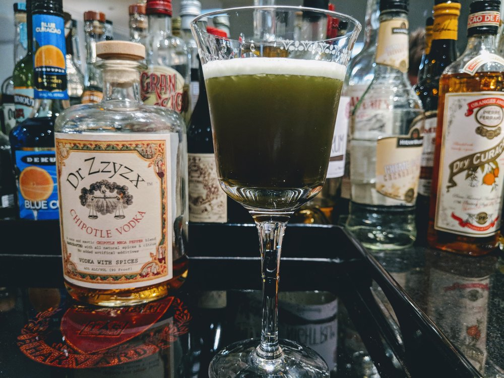 GREEN RATTLER - 2 oz Dr. Zzyzx Chipotle Vodka1/4 oz Blue Curacao1 teaspoon Creme de CacaoSplash of Averna or FernetShake with ice and strain
