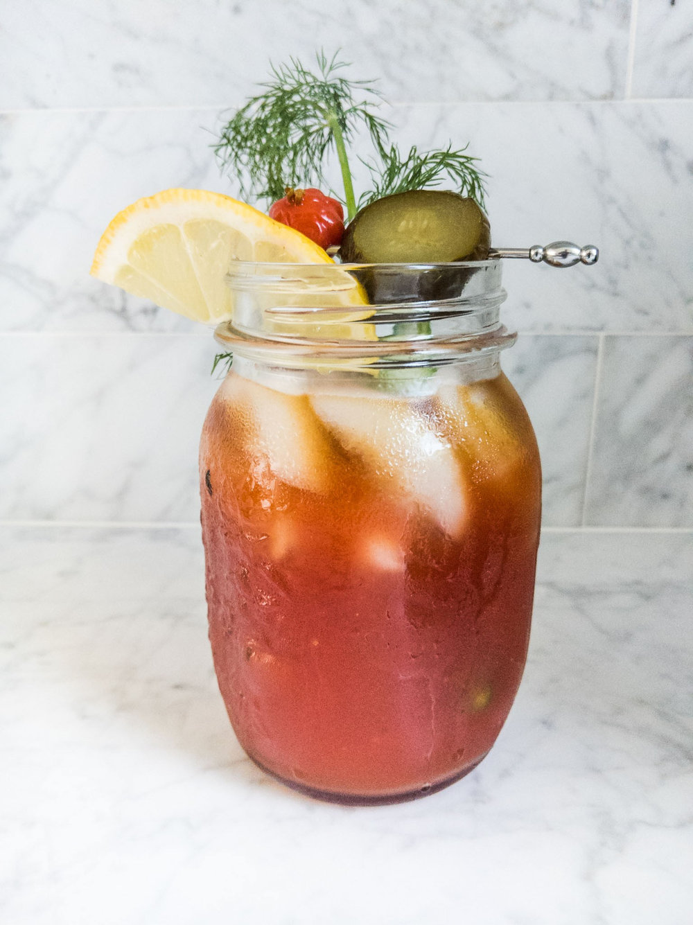 CHIPOTLE BLOODY MARY - 2.5 oz of tomato juice1/2 oz of bread & butter pickle juice1/4 oz Frankie V Habanero Hot Sauce (or other favorite hot sauce)2 dashes of Worcestershire sauce2 oz of Dr. Zzyzx Chipotle VodkaSqueeze of lemon