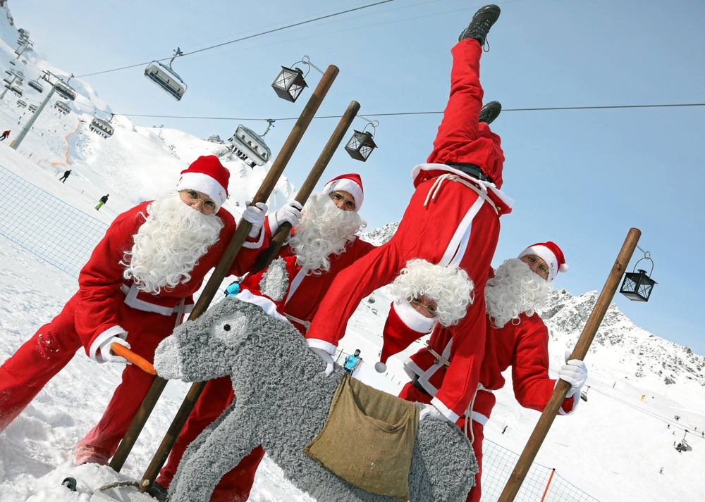Bunch of Santas and a donkey. photo by  ClauWau