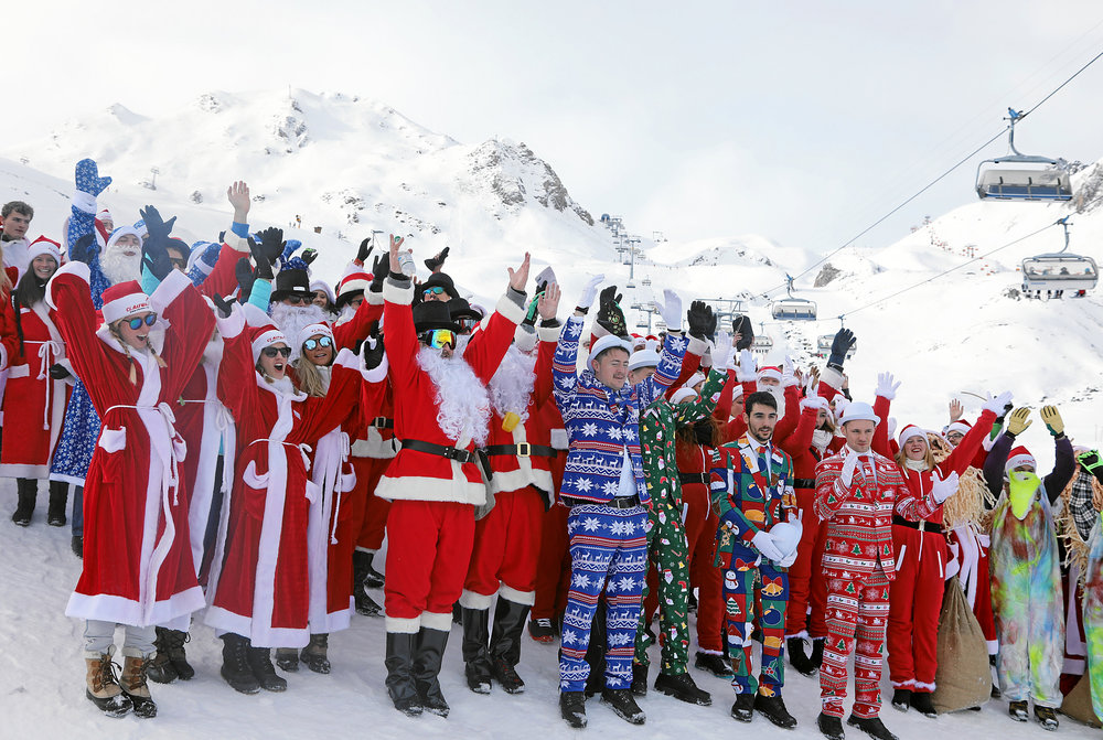 Whole lotta Santas! Photo courtesy of  Engadin Samnaun Val Mustair