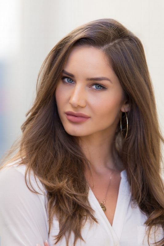 Close up headshot of beautiful, female, brunette model.