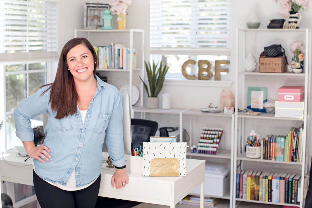 Chelsea B. Foster standing in front of her beautiful home office space in Sunnyvale, CA.