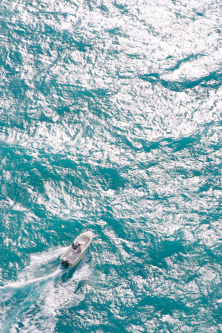 Robert Holland high altitude aerial of small boat in large offshore waves_Y0U5566-(1).jpg