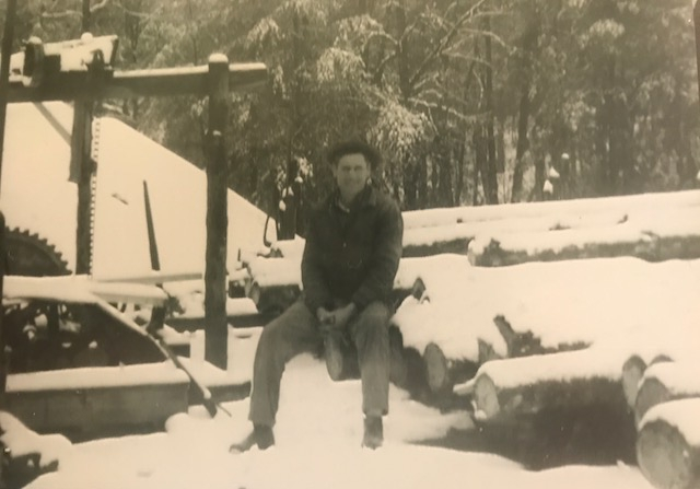 Charlie Attaway McConnell (Tonya's grandfather) sitting on a freashly cut stack of logs on what is now known as McConnell Wood Products, which his father Drake McConnell started and is currently still in operation today!