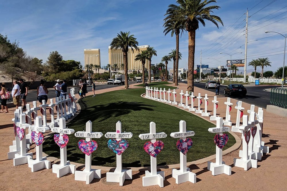 Memorial crosses at the Las Vegas sign