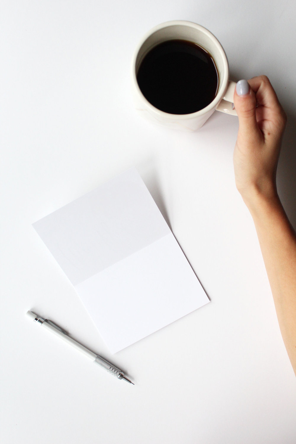 blank card with hand on cup of coffee