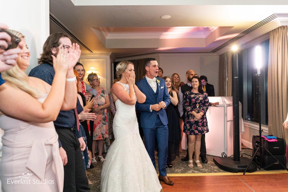 bride and groom suprised by flash mob at wedding
