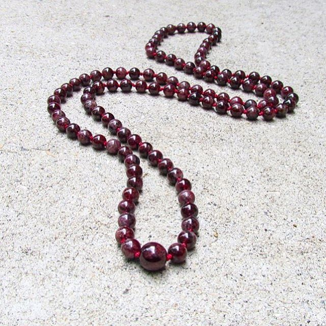 📿Did you know the word garnet is derived from the Latin word, granatum, meaning pomegranate? This hand-knotted Garnet Meditation Mala is one of three new malas fresh off the press and in the shop now (link in bio). #ashleymaegall #meditation #mala #garnet #gemstone #108 #beads