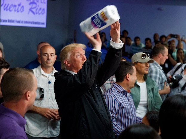 DRUNK with power.   Like a mascot at a basketball game, Mr. Trump gently tossed rolls of paper towels into a crowd that gathered to see him at his photo op VISIT OF THE DARKIES at Calvary Chapel IN PUERTO RICO. [   MORE   ]