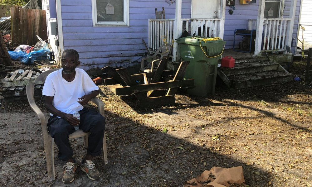 Joseph Cobbs sits in his friend's yard, manning the generator for the block in Wilmington's Northside. 'All the white people around us got power. We got none.' [   MORE   ]