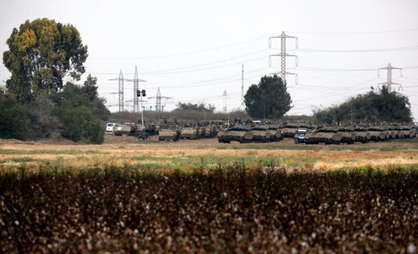 Armoured Israeli military vehicles are seen gathered in an open area near Israel's border with Gaza Strip October 18, 2018.