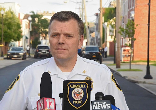 Acting police chief Mike Basile briefs the press at the scene of a police involved shooting on the 300 block of Elk St. on Monday, Aug. 20, 2018 in Albany,