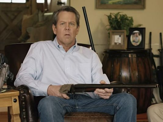 IN PHOTO NEUROPEON BRIAN KEMP WHO STOLE THE GA GUBERNATORIAL ELECTION THROUGH VARIOUS METHODS OF UNDERCOUNTING BLACK VOTES.