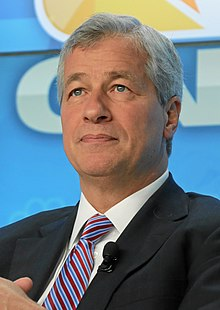 "In 2004 JP Morgan Chase admitted that it profited from the enslavement of Blacks. It acknowledged owning 13,000 slaves. COO Jamie Dimon [racist suspect in photo] said J.P. Morgan was sorry for contributing to a ""brutal and unjust institution"" and outlined how it planned to repair the damage. [   MORE   ]    Wells Fargo & JP Morgan are the Chief Financiers of Private Prison Companies [CoreCivic & GeoGroup] Profiting Off the Incarceration of Non-White Immigrants [   MORE   ]    JPMorgan Chase & Co rarely lends money to Black people. [   MORE   ] and has charged them more for car loans. [   MORE   ]    JP Morgan also got paid exploiting inmates released from prison using their debit cards/ [   MORE   ]"