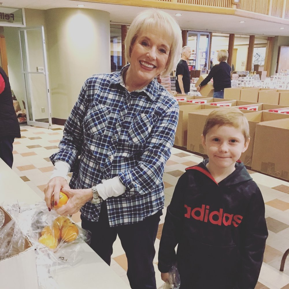 Helping Grammy at her church during the holidays. They prepared food to be delivered to those who needed it.