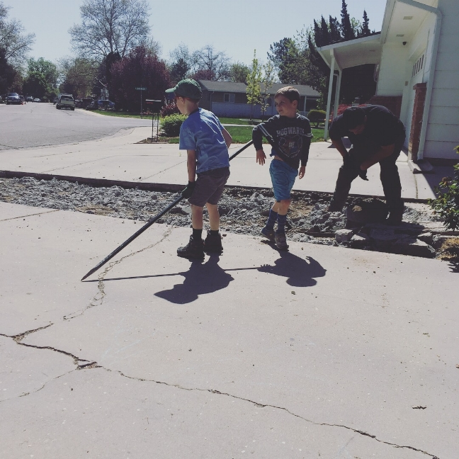 Rico and Fredhead helping haul concrete from the driveway. They asked if they could help.