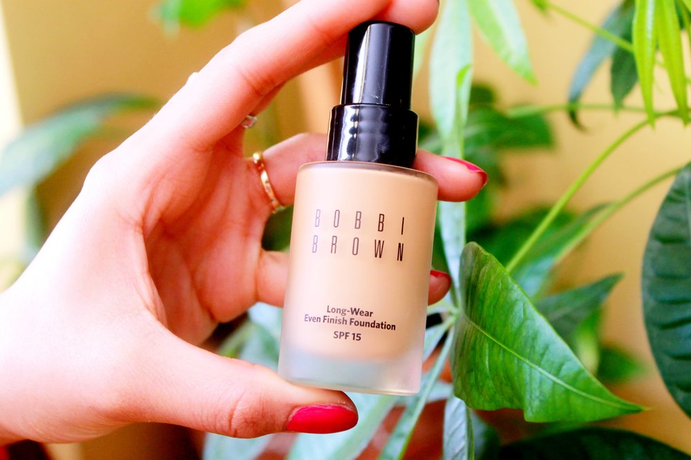 Bobbi Brown Long-Wear Even Finish Foundation SPF 15 in Warm Natural: - Perfect for my oily skin because it's oil-free, lightweight and full-coverage. I'm on my second bottle because I love it so much!
