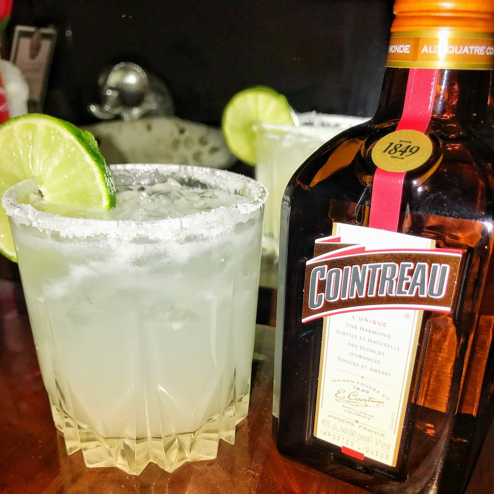 The Original Margarita - 1 oz Cointreau2 oz Blanco Tequila1 oz Fresh Lime JuiceDirections:Mix Cointreau with tequila in a cocktail shaker. Add 1 oz of lime juice or cut limes in half and squeeze 2-3 halves in the shaker. Add ice and shake until the shaker starts to frost. Grab your glass and use one of the limes to rub the rim of the glass. Have the salt ready on a saucer or small plate and dip the rim in sugar, salt or whatever you're in the mood for. Finish it off with a slice of lime for garnish and sip!