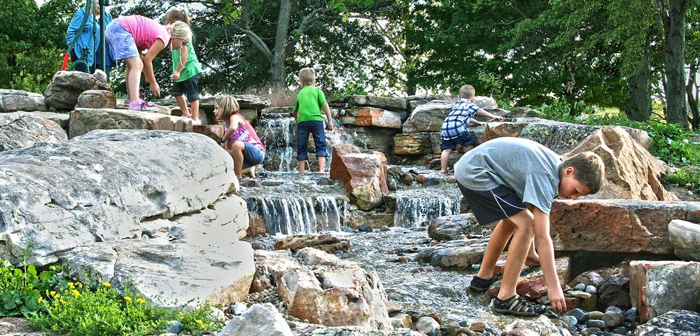 girls and boys with water in nature playscale.jpg