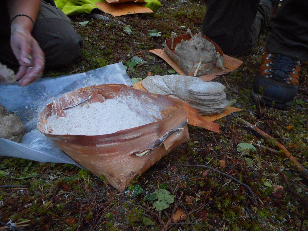 self made bread in nature survival skills in Finland