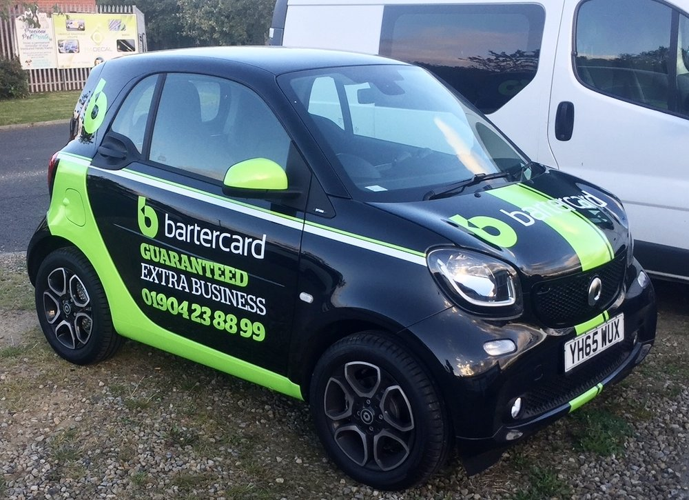 BARTERCARD SMART CAR   Effective use of vehicle graphics turned this Smart Car into a head turning advert for the company.