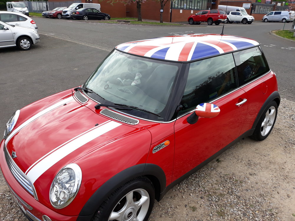 MINI COOPER SPORT   The effective use of vehicle graphics turned this Mini Cooper Sport into an eye catching, retro work of art! The results are amazing!