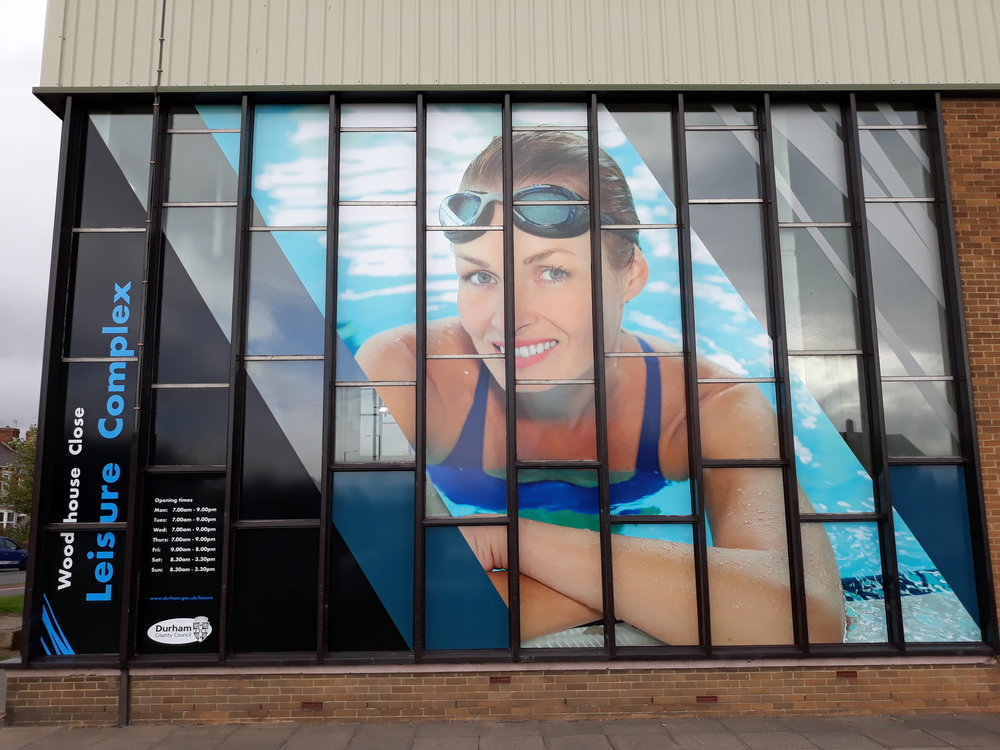 DURHAM WOODHOUSE LEISURE CENTRE   Large scale graphics fitted externally across 20+ different windows.