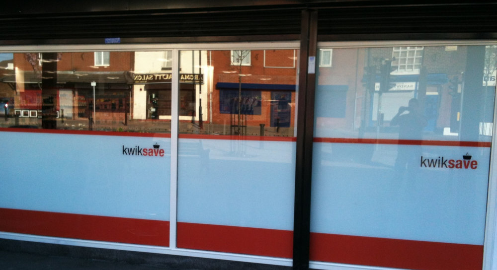 KWIK SAVE   Window graphics fitted internally.