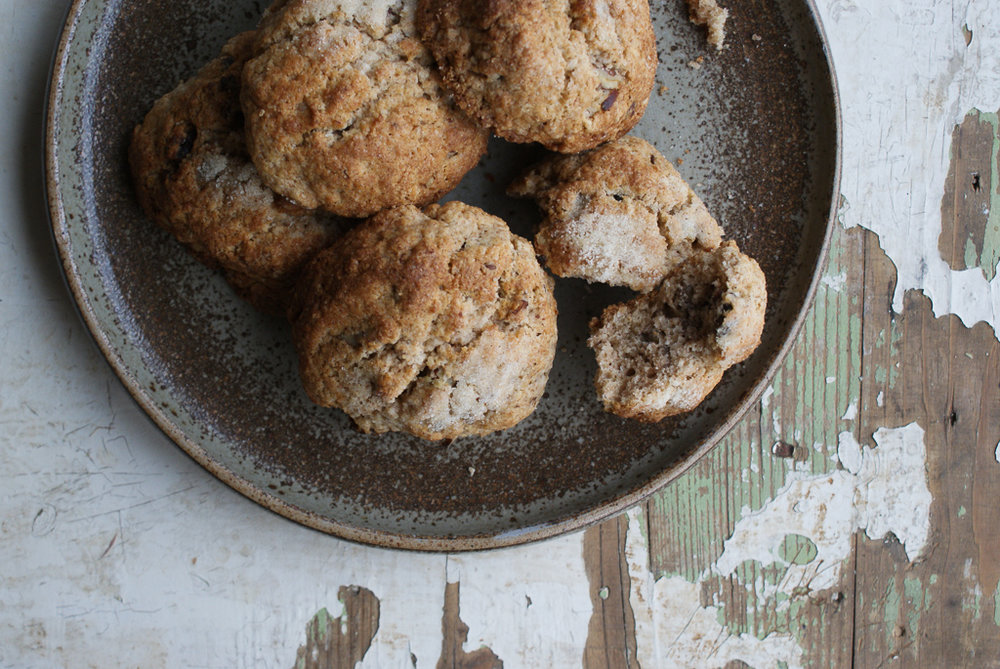Pecan & Date Rock Cakes    ingredients    * 100g plain flour * 125g Spelt flour * 2 tsp baking powder * 1/2 tsp salt * 1 tsp mixed spice * 125 grams unsalted butter * 75 grams golden caster sugar *60 grams pecans chopped * 65 grams dates chopped * 1 large egg lightly beaten * 2 -4 tbsp milk    method    preheat your oven to 200C / 400 F /gas mark 6 and line a large baking sheet with baking paper * in a large mixing bowl combine the flours, baking powder, salt & mixed spice * rub the butter into the mixture until it resembles fine breadcrumbs * add the sugar, pecans & dates & mix * pour in the lightly beaten egg, & add the milk a little at a time until it all comes together, you don't want it to be too sticky * divide the mixture in to 10-12 balls, place on the baking sheet & lightly squish with a fork, sprinkle a little sugar on top * bake for 15-20 minutes until golden * leave to cool down    enjoy!