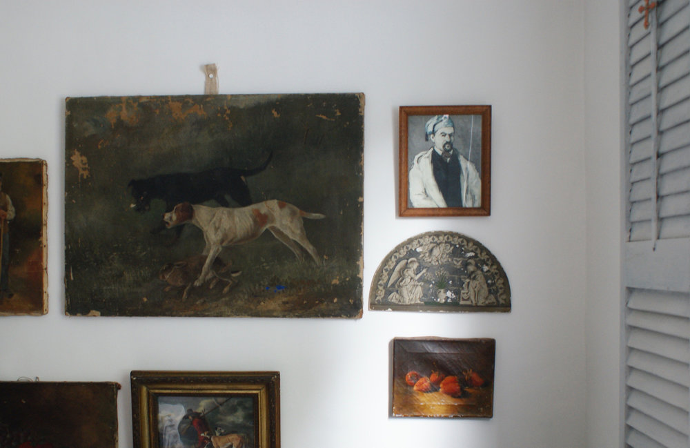 a unique collection of paintings, canvases & prints in the living room. The strawberries are our favourite!