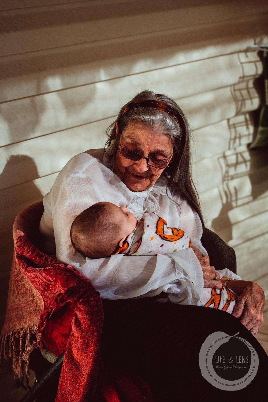 Grandy holding one of her Great Grandchildren, my second daughter, Clover.
