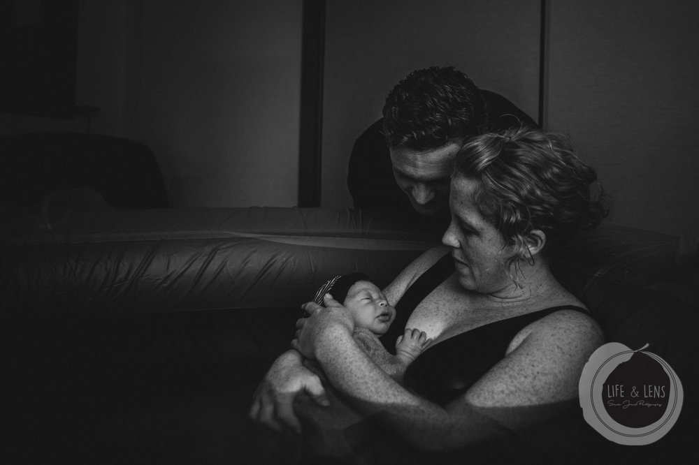sydney birth photographer - mother and father embracing after the homebirth of their baby