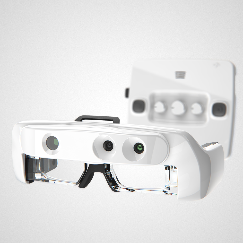 The Helios headset in glossy white from the front view, with the control box blurred in the background