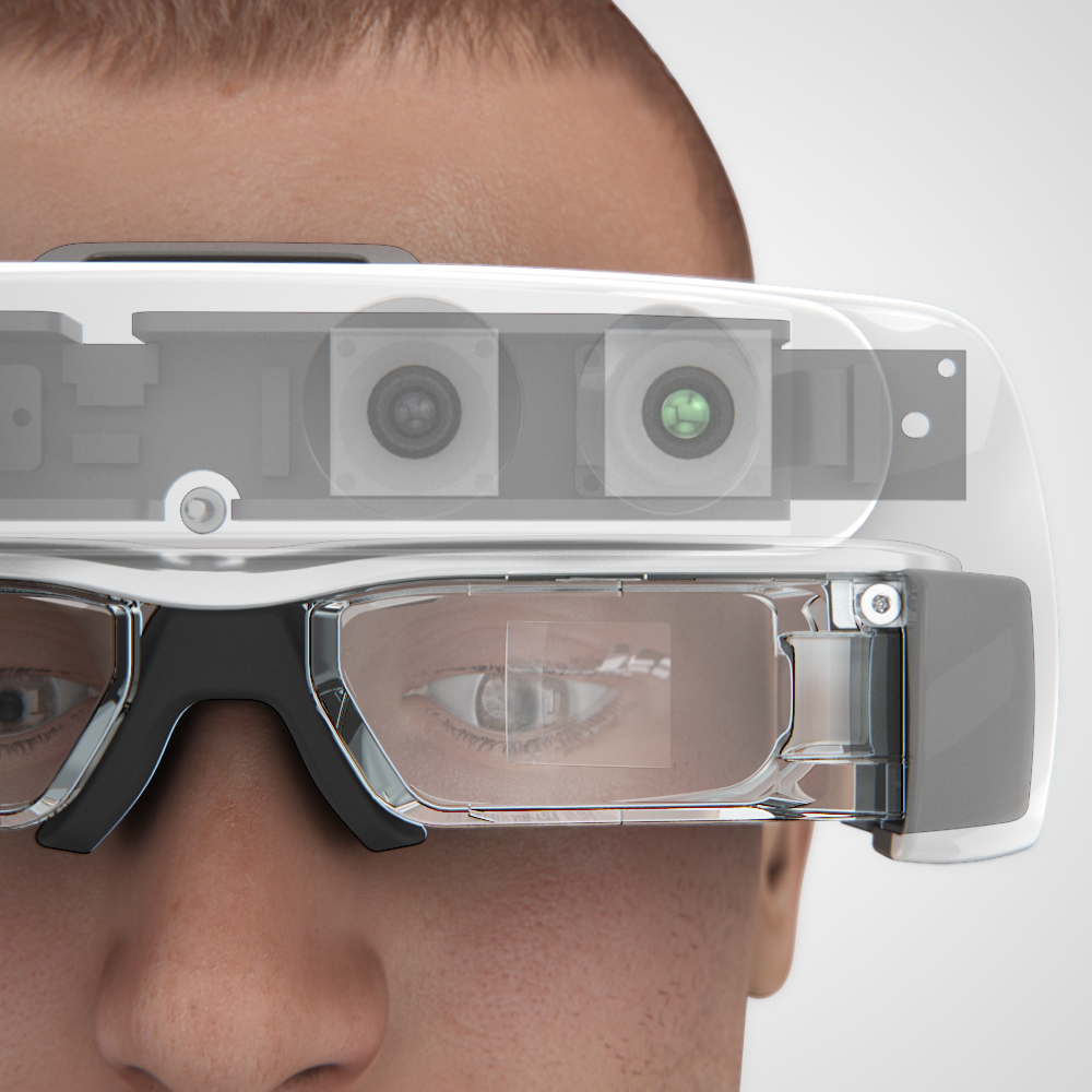 Front view of the transparent Helios headset with a view of the internals, being worn by a man