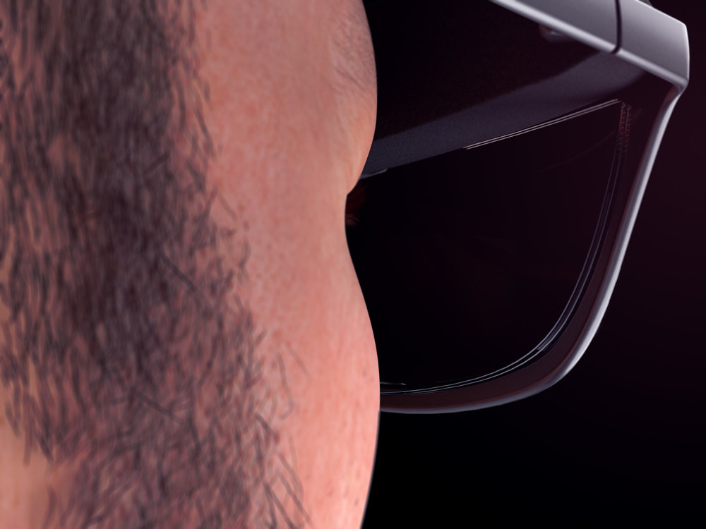 Close-up view render of a man wearing a pair of concept WaveOptics glasses