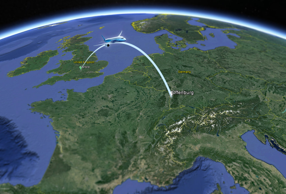 A plane flying an imaginary path from Oxford UK to Offenburg, Germany over a globe view of Earth