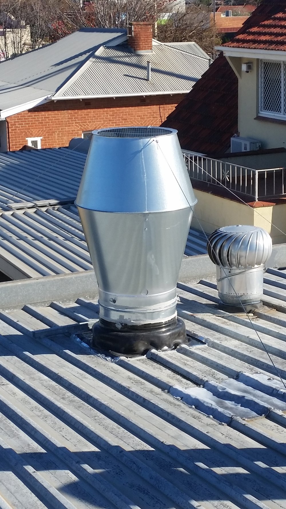 Exhaust weather cowls