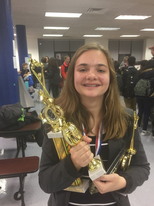 girl-smiling-with-trophy.jpg