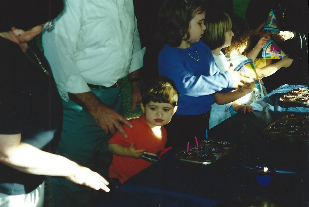 """The birthday candles were on the cupcakes — """"2 plus 1 to grow""""— and my cousins were passing down the Barney hats. Then the reaction started."""