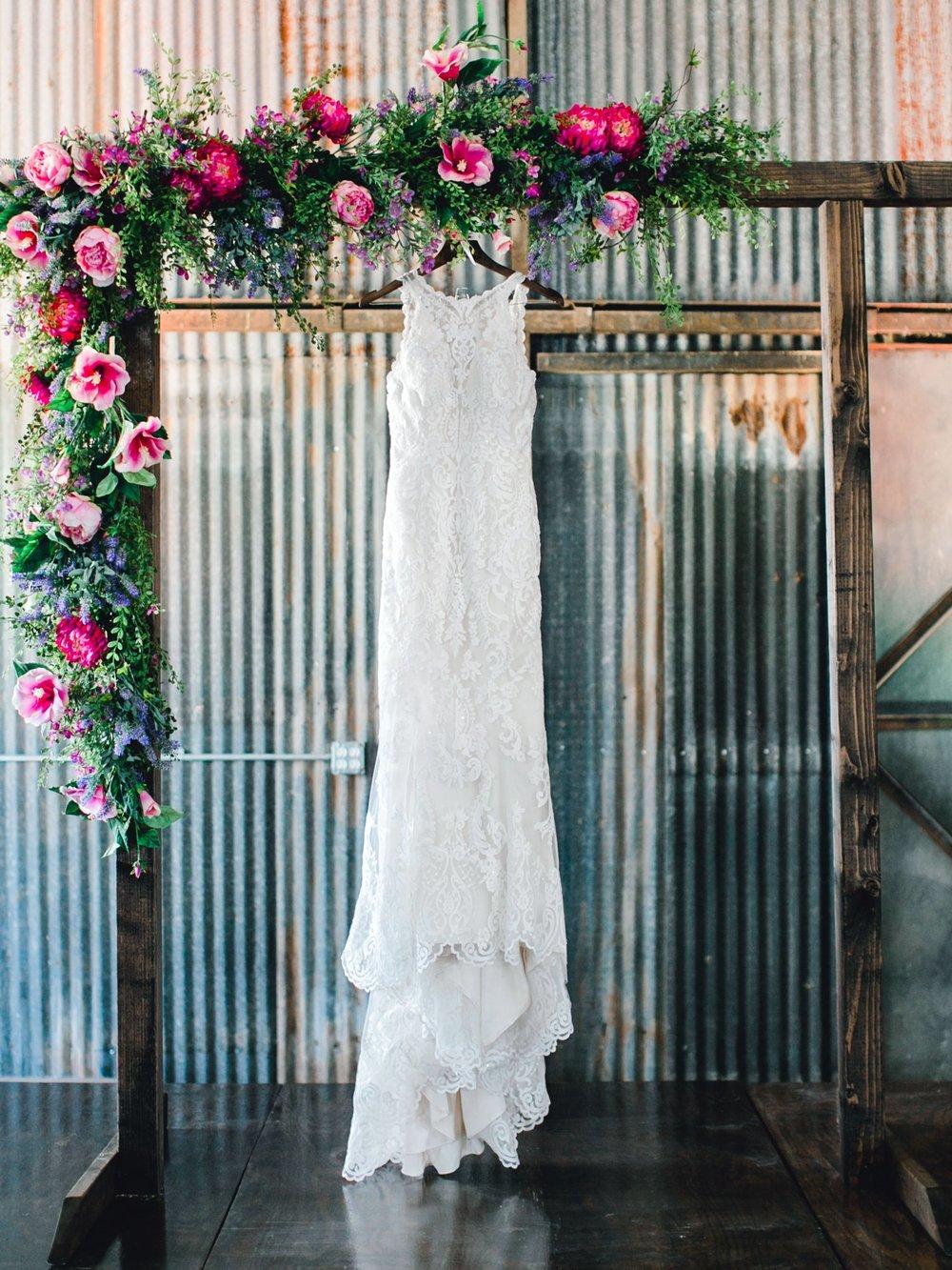 Jenna-and-garrett-Everett-kitalou-gin-lubbock-wedding-dayspring-designs-lubbock-wedding-photographer_0002.jpg