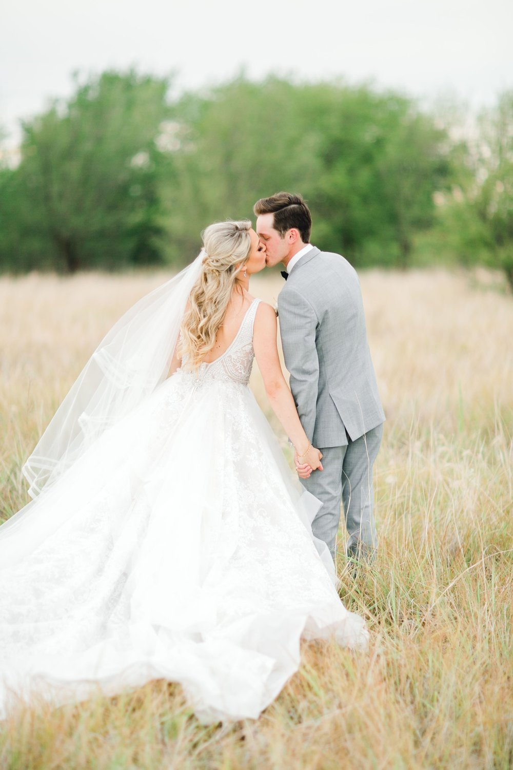 KAITLYN_AND_ZACHARY_HUNT_ALLEEJ_LUBBOCK_WEDDING_PHOTOGRAPHER_EBERLEY_BROOKS_EVENTS_0142.jpg
