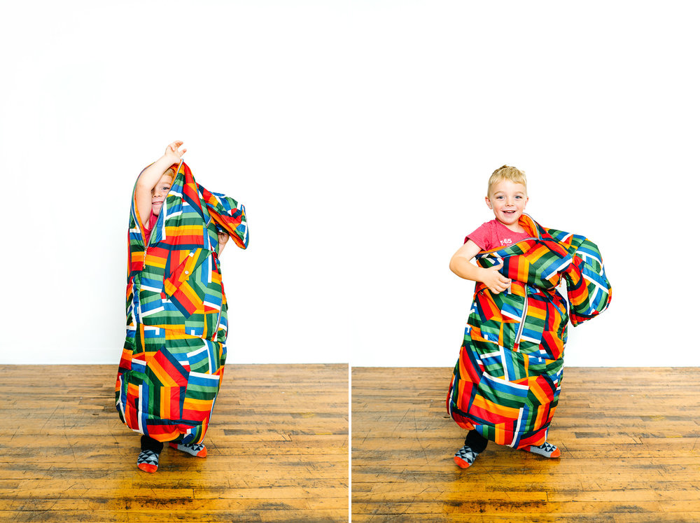 A Child In A Poler Napsack