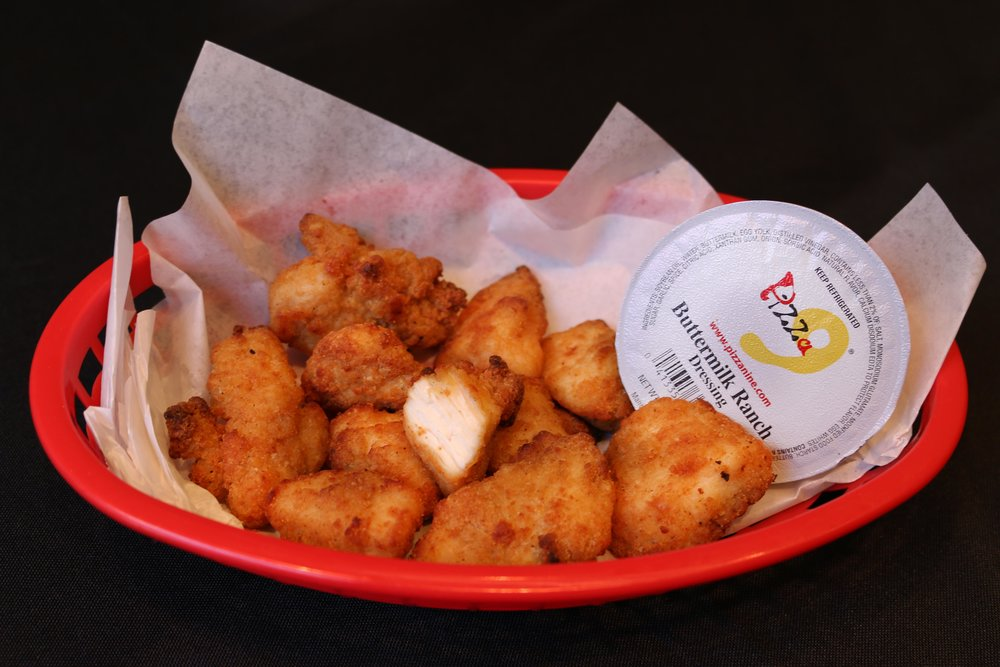Chicken Bites- Tender breaded chicken prepared with a crispy outer coating, accompanied by a delicious dipping sauce!