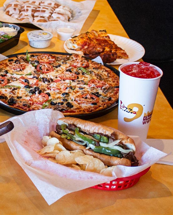 Veggie Delight Pizza & Italian sandwich-  Our vegetarian pizza is topped with mushrooms, onions, bell peppers, black olives, & tomatoes. Can't decide between pizza or sandwich? Get both!