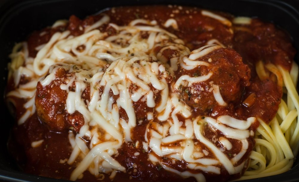 Spaghetti With Meatballs-  Spaghetti noodles topped with marinara sauce, tasty meatballs & mozzarella cheese.