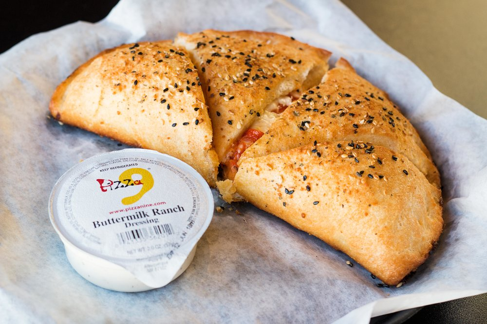 Pepperoni Pizza Roll-  Fresh pizza dough, rolled with our delicious pizza sauce, cheese & pepperoni. Served with a side of ranch.