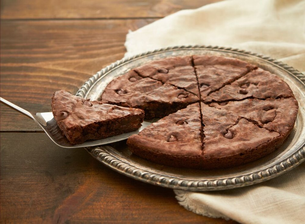 Pizza Brownie- Sweet, milk chocolate brownies baked with chocolate chip pieces. Add a dessert to your pizza order!