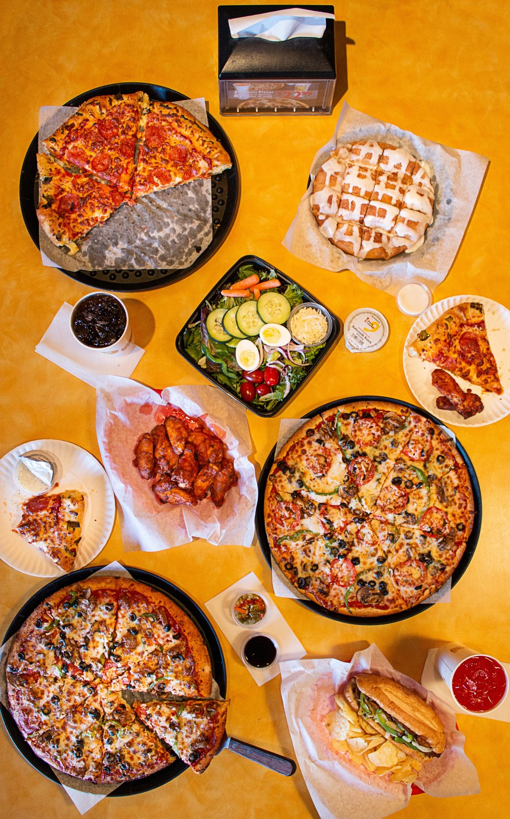 Pizza 9 Dinner-  Party planning? Let us help! Check out our great party pack pizza deals!
