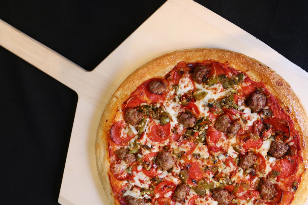Deep Dish Lobo Pizza-  Made with our fresh daily prepared pizza dough, then topped with pepperoni, sausage & green chile.